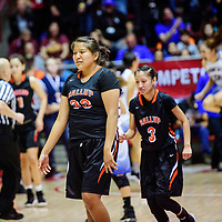 Gallup Bengals Leona Smith (33), center,  and Amanda Mitchel (3) leave the court after playing the Bloomfield Bobcats during a District 5A semifinal at The Pit in Albuquerque Thursday.  The Bengals fell to the Bobcats 59-56.