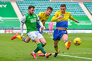 Michael O'Halloran (#11) and Callum Booth (#24) of St Johnstone FC try to prevent Drey Wright (#8) of Hibernian FC from crossing the ball during the SPFL Premiership match between Hibernian and St Johnstone at Easter Road Stadium, Edinburgh, Scotland on 1 May 2021.
