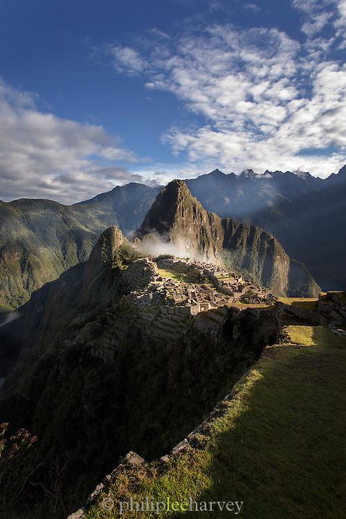 Early morning over Machu Picchu, Cusco Region, Urubamba Province, Machupicchu District in Peru, South America
