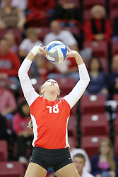 29 October 2011: Kaitlyn Early sets the ball for a strike During a match between the Creighton Bluejays and the Illinois State Redbirds at Redbird Arena in Normal Illinois