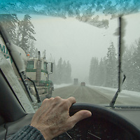 WINTER DRIVING. Dangerous and slippery conditions on Snoqualmie Pass, Interstate 90, east of Seattle Washington.
