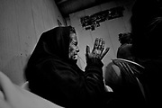 """A woman praying.<br /> The gipsies call it """"the Cult"""", it is a kind of pact that they get together twice a week in a common hut to pray for good and exorcise the evil. Inside the hut there´s a heavy atmosphere and things seem to be a blend of fantasy and reality. Tens of gipsies form a circle of screams and cries and you can hear a mix of prays, complains, desperation and guilt. A gipsie women faints on the floor almost like she has been exorcised and she had a demon inside her, slowly with the help of the others she recovers.<br /> The truth is that the cult is a way that gipsies chose to express themselves, something that is very much theirs, just like the sound of the gipsies guitars, shows something very real, the suffering of their spirits."""