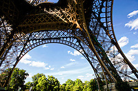 A unique view of the bottom arch of the Eiffel Tower, Paris France.