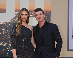 July 22, 2019 - Los Angeles, CA, USA - LOS ANGELES - JUL 22:  April Love Geary, Robin Thicke at the ''Once Upon a Time in Hollywood'' Premiere at the TCL Chinese Theater IMAX on July 22, 2019 in Los Angeles, CA (Credit Image: © Kay Blake/ZUMA Wire)