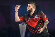 Michael Smith throwing the darts during the 2019 William Hill World Darts Championship Final at Alexandra Palace, London, United Kingdom on 1 January 2019.