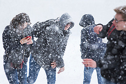 © Licensed to London News Pictures. 27/02/2018. London, UK. A group of friends have a snowball fight on Horse Guards Parade in central London as heavy snow falls. Severe cold, blizzards and heavy snow are expected for the rest of the week as the 'Beast from the East' brings freezing Siberian air to the UK. Photo credit: Rob Pinney/LNP