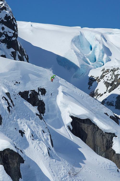 Michael Novotny snowboards down a mountain in Valdez, Alaska. MR