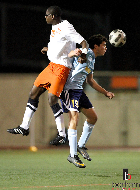 Heritage High's Sufian Alani, right, gets control of the ball against Pittsburg High's Melvin Swen during their game at Pittsburg High School on Tuesday, January 10, 2012. (Photo by Kevin Bartram).