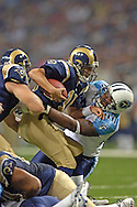 St. Louis Rams quarterback Marc Bulger (10) gets sacked by Tennessee defensive tackle Randy Starks (90) for a 6-yard loss early in the first quarter.  The St. Louis Rams defeated the Tennessee Titans 31-27 at the Edward Jones Dome in St. Louis, Missouri on September 25, 2005.