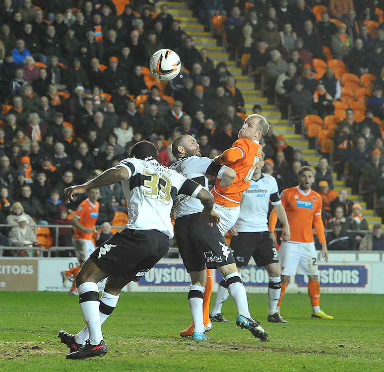 Blackpool's Neil Bishop's headed shot goes wide<br /> <br /> Photo by Dave Howarth/CameraSport<br /> <br /> Football - The Football League Sky Bet Championship - Blackpool v Derby County - Tuesday 8th April 2014 - Bloomfield Road - Blackpool<br /> <br /> © CameraSport - 43 Linden Ave. Countesthorpe. Leicester. England. LE8 5PG - Tel: +44 (0) 116 277 4147 - admin@camerasport.com - www.camerasport.com