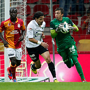 Galatasaray's Dany Nounkeu, Nestor Fernando Muslera and Akhisar Belediyespor's Kursat Duymus during their Turkish Super League soccer match Galatasaray between Akhisar Belediyespor at the TT Arena at Seyrantepe in Istanbul Turkey on Sunday 23 September 2012. Photo by TURKPIX