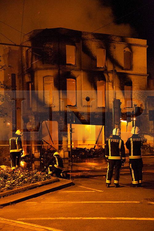 © Licensed to London News Pictures.  FILE PICTURE DATED 09/08/2011 LONDON, UK. Firefighters deal with the House of Reeves furniture store in Croydon after it was set alight by rioters in the town.  Croydon was one of several London boroughs and English cities hit by a third night of rioting and looting. Photo credit: Matt Cetti-Roberts/LNP