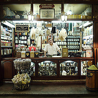 Istanbul , Turkey 06 July 2005<br /> A shop in the Grand Bazaar of Istanbul.<br /> The Grand Bazaar (or Covered Bazaar) in Istanbul is one of the largest covered markets in the world with more than 58 streets and 4,000 shops, and has between 250,000 and 400,000 visitors daily. <br /> It is well known for its jewelry, pottery, spice, and carpet shops. <br /> The bazaar contains two domed masonry structures built for storage and safe keeping, the first of which was constructed between 1455 and 1461 by the order of Sultan Mehmed the Conqueror. <br /> The bazaar was vastly enlarged in the 16th century, during the reign of Sultan Suleiman the Magnificent, and in 1894 underwent a major restoration following an earthquake.<br /> Photo: Ezequiel Scagnetti