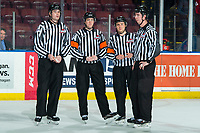 KELOWNA, BC - JANUARY 3: Line officials Cade Cooke and Brett Mackey stand on the ice with referees Trevor Nolan and Mark Pearce at the Kelowna Rockets against the Victoria Royals  at Prospera Place on January 3, 2020 in Kelowna, Canada. (Photo by Marissa Baecker/Shoot the Breeze)