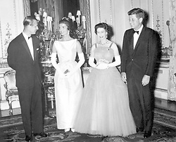 President John Kennedy (right) with his wife (second left) Jacqueline, meeting Queen Elizabeth II and the Duke of Edinburgh on the American President's visit to Britain.