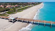 Juno Beach and the pier during the COVID 19 pandemic, when local beaches were closed to minimize the spread of the Corona Virus.
