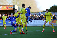 Fleetwood Town defender Danny Andrew (3) watches as AFC Wimbledon attacker Shane McLoughlin (19) scores a header during the EFL Sky Bet League 1 match between AFC Wimbledon and Fleetwood Town at the Cherry Red Records Stadium, Kingston, England on 8 February 2020.
