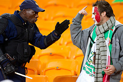 Policemen and fan of Mexico after the 2010 FIFA World Cup South Africa Round of Sixteen match between Argentina and Mexico at Soccer City Stadium on June 27, 2010 in Johannesburg, South Africa. (Photo by Vid Ponikvar / Sportida)