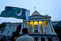 Mohammad Asem, 15 of West Sacramento, holds the Pakistani flag during the interfaith vigil on the set steps of the State Capitol, for murdered Pakistani students and other victims of terror, Saturday December 20, 2014. The Sacramento's Pakistani and Muslim community prayed for the families of the 144 children and teachers slaughtered by the Taliban terrorists at the military school in Peshawar, northern Pakistan last December 16th.<br /> Brian Baer/Special to the Bee