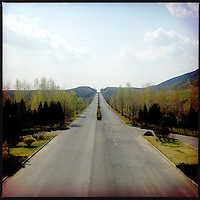 A long stretch of empty highway in North Korea.