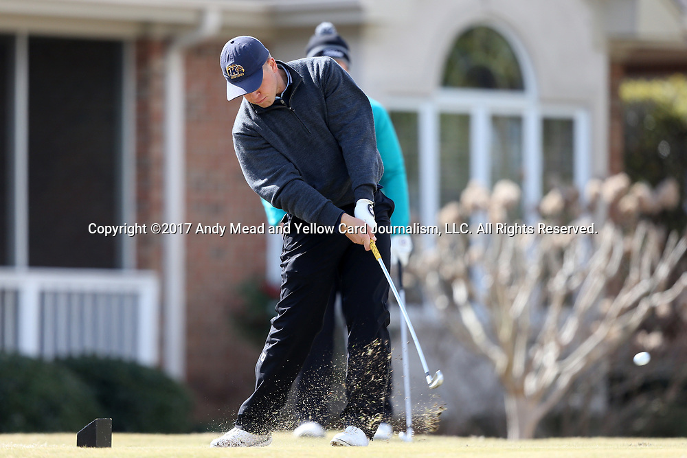WILMINGTON, NC - MARCH 19: Kent State's Bjarki Petursson (ISL) tees off on the Ocean Course eighth hole. The first round of the 2017 Seahawk Intercollegiate Men's Golf Tournament was held on March 19, 2017, at the Country Club of Landover Nicklaus Course in Wilmington, NC.
