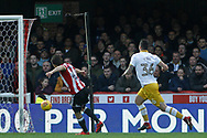 Lasse Vibe of Brentford (L) scores his team's first goal. EFL Skybet football league championship match, Brentford v Sheffield Wednesday at Griffin Park in London on Saturday 30th December 2017.<br /> pic by Steffan Bowen, Andrew Orchard sports photography.