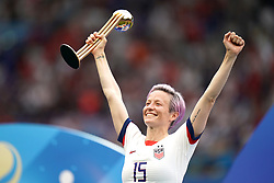 USA's Megan Rapinoe celebrates with the FIFA Women's World Cup Trophy after the final whistle