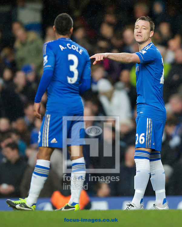 Picture by Alan Stanford/Focus Images Ltd +44 7915 056117.17/03/2013.John Terry of Chelsea gives instructions to Ashley Cole during the Barclays Premier League match at Stamford Bridge, London.