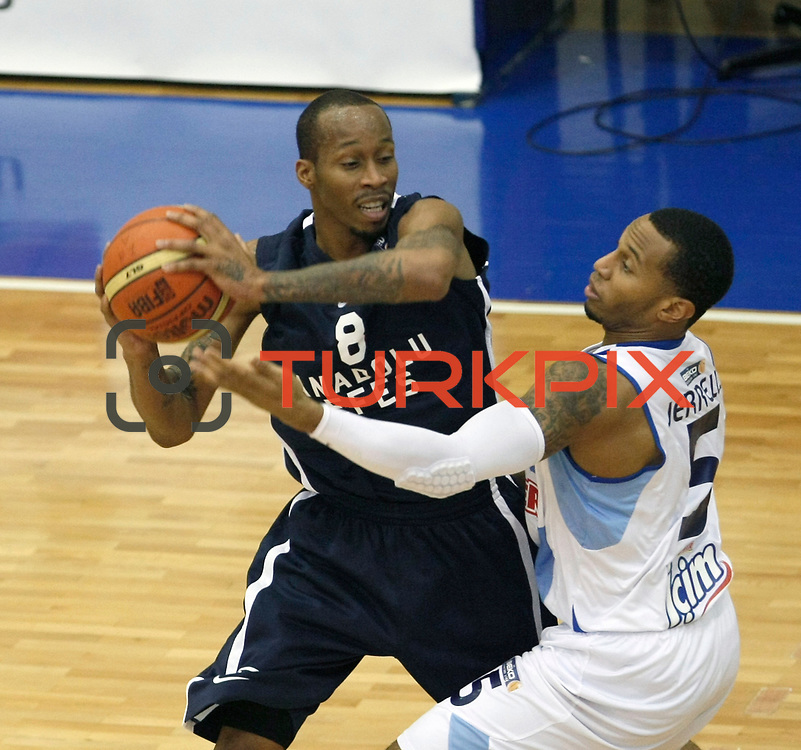Fenerbahce Ulker's Curtis Jerrells (R) and Anadolu Efes's Terence Kinsey (L) during their Turkish Basketball league derby match  Fenerbahce Ulker between Anadolu Efes at Caferaga Sports Hall in Istanbul, Turkey, Saturday 01, 2012. Photo by TURKPIX