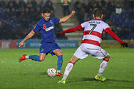 AFC Wimbledon defender Luke O'Neill (2) battles for possession with Doncaster Rovers midfielder Kieran Sadlier (7) and about to pass the ball during the The FA Cup match between AFC Wimbledon and Doncaster Rovers at the Cherry Red Records Stadium, Kingston, England on 9 November 2019.