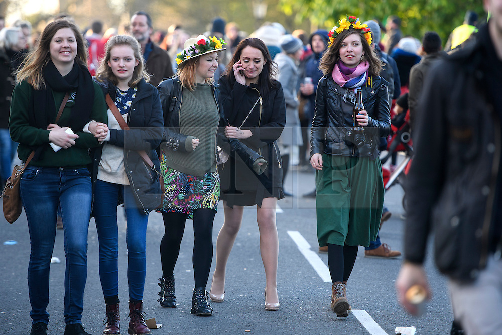 © London News Pictures. 01/05/2016. Oxford, UK.  A group of young women begin the journey home following May Day day celebrations in the early hours of the morning near Magdalen Bridge in Oxford, Oxfordshire. This year people were again prevented from jumping from the bridge in to the water due to serious injuries sustained at a previous years event . Photo credit: Ben Cawthra/LNP