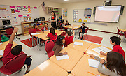 Beverly Banda works on a lesson with her first grade students on the first first day of class at the new Sherman Elementary School, December 2, 2013.