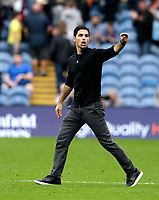 Football - 2021 / 2022 Premier League - Burnley vs. Arsenal<br /> <br /> Arsenal head coach Mikel Arteta raises his hand to the travelling fans after his struggling team gained a 1-0 win, at Turf Moor.<br /> <br /> <br /> COLORSPORT/ALAN MARTIN