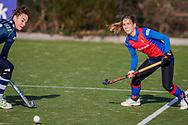 BILTHOVEN -  Hoofdklasse competitiewedstrijd dames, SCHC v hdm, seizoen 2020-2021.<br /> Foto: Eva van 't Hoog (hdm) en Miloe Jaeger (SCHC)