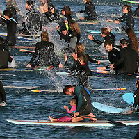 Hundreds of surfers and paddlers, some with young ones in tow, participate in a Black Lives Matter paddle out in the Monterey Bay in memory of George Floyd on Sunday. Hundreds also jammed West Cliff to witness and support the event, which left from Cowell Beach in Santa Cruz. (Shmuel Thaler — Santa Cruz Sentinel)