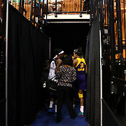 Sisters Chiney Ogwumike, (left), Connecticut Sun and Nneka Ogwumike, Los Angeles Sparks, head back to the dressing rooms after the Connecticut Sun Vs Los Angeles Sparks WNBA regular season game at Mohegan Sun Arena, Uncasville, Connecticut, USA. 3rd July 2014. Photo Tim Clayton