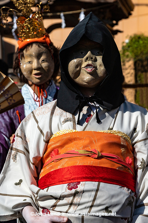 Okame Fat Faced Woman and Midwife at Mengake Kamakura - Mengake or Masked Parade at Goryo Jinja shrine.  At this festival held in September a group of ten people take part in this annual ritual: 8 men and 2 women. Wearing comical or grotesque masks that signify different demons, legends and dieties  leave the shrine and parade through the nearby streets accompanied by portable shrine and festival music.