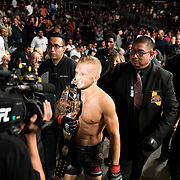 In the main event, TJ Dillashaw (black trunks) retains his bantamweight title belt with a first round TKO of Cody Garbrandt at UFC 227 held at the Staples Center in Los Angeles on August 4, 2018. Photo by Todd Bigelow for ESPN.