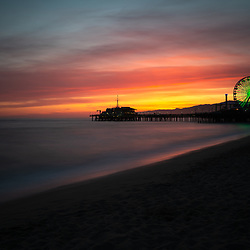 Santa Monica Pier sunset photo along the Pacific Ocean in Southern California. Copyright ⓒ 2017 Paul Velgos with All Rights Reserved.
