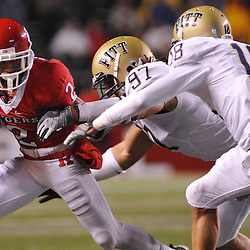 Oct 16, 2009; Piscataway, NJ, USA; Rutgers wide receiver Tim Brown (2) evades Pittsburgh defensive tackle Jabaal Sheard (97) and cornerback Jarred Holley (18) during second half NCAA football action in Pittsburgh's 24-17 victory over Rutgers at Rutgers Stadium.