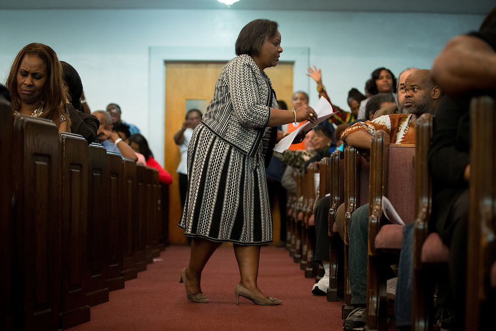 Attorney Angela Johnson hands out petitions during a rally at First Iconium Baptist Church in Atlanta on Tuesday, April 7, 2015, to ask for leniency in the sentencing of 11 Atlanta Public Schools educators found guilty of cheating. Sentencing will take place Monday. Photo by Kevin Liles for The New York Times