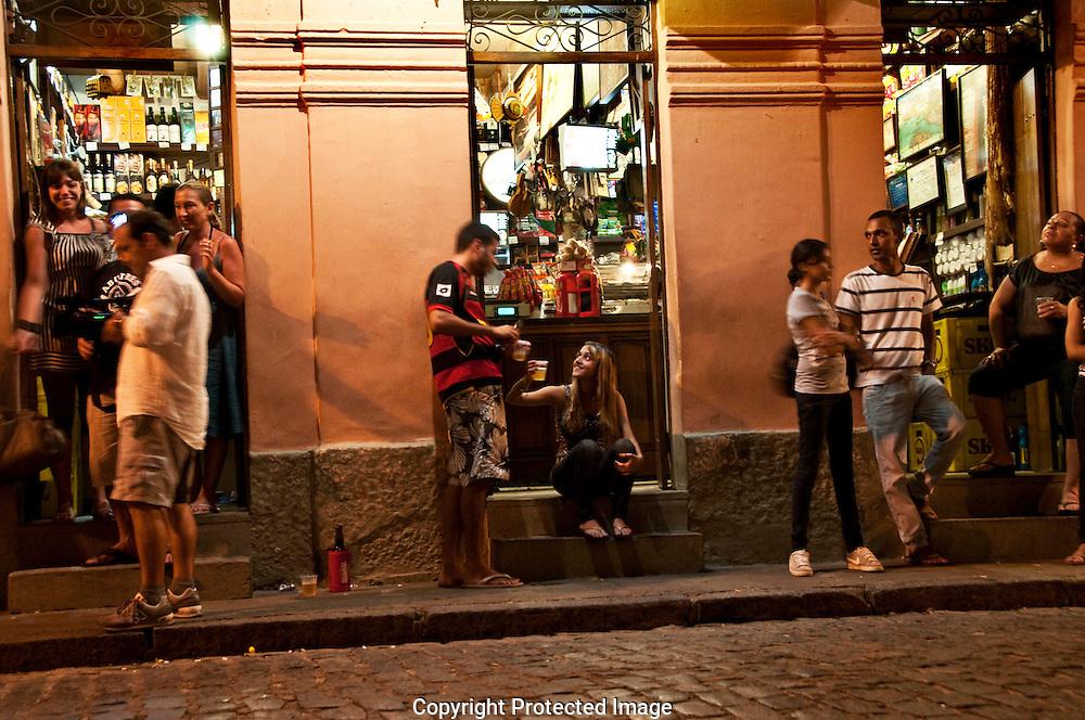 People sitting in street at bar in Olinda Northeastern  Brazil
