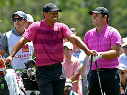 May 3, 2018 - Charlotte, NC, USA - Tiger Woods, left, and Patrick Reed, right, enjoy a laugh at the 3trd tee box during he first round of the Wells Fargo Championship at Quail Hollow Club in Charlotte, N.C., on Thursday, May 3, 2018. (Credit Image: © Jeff Siner/TNS via ZUMA Wire)