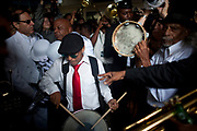 Musicians play during a jazz funeral for Lionel Batiste in New Orleans, July 20, 2012. Batiste, who died July 8, was a jazz legend in the city and bass drummer and assistant grand marshal of the Treme Brass Band. (Andrew Stanfill/Special to the Sun)