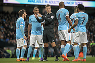 The referee indicates a penalty despite the Manchester City players complaining during the Barclays Premier League match between Manchester City and Tottenham Hotspur at the Etihad Stadium, Manchester, England on 14 February 2016. Photo by Mark P Doherty.