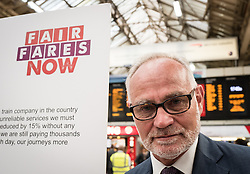 © Licensed to London News Pictures. 10/08/2016. London, UK. Crispin Blunt MP joins commuters at a protest for 'fairer fares' in Victoria Station, London. Southern Rail staff have called off the final two days of a week-long strike over job losses and passenger safety. Photo credit: Rob Pinney/LNP