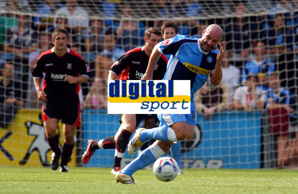 Photo: Alan Crowhurst.<br />Wycombe Wanderers v Lincoln City. Coca Cola League 2. 23/09/2006. Wycombe's Tommy Mooney (R) never gives up the chase.