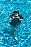 Summer holiday child submerged in a swimming pool