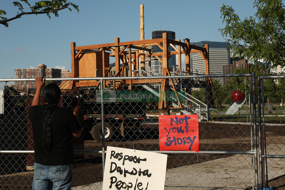 May 26, 2017 - Minneapolis, Minnesota, U.S. - Protesters sat outside the Minneapolis Sculpture Garden in response to 'Scaffold' by Sam Durant which depicts the 1862 hangings of 38 Dakota men Friday in Minneapolis. On December 26, 1862 on the day after Christmas, 38 Dakota (Santee Sioux) were put to death by hanging. The deaths were ordered by President Abraham Lincoln, the Great Emancipator. The hangings were the result of the Dakota War of 1862, which terminated the rights of Dakota people from living in Minnesota at that time. (Credit Image: © Anthony Souffle/Minneapolis Star Tribune/ZUMAPRESS.com)