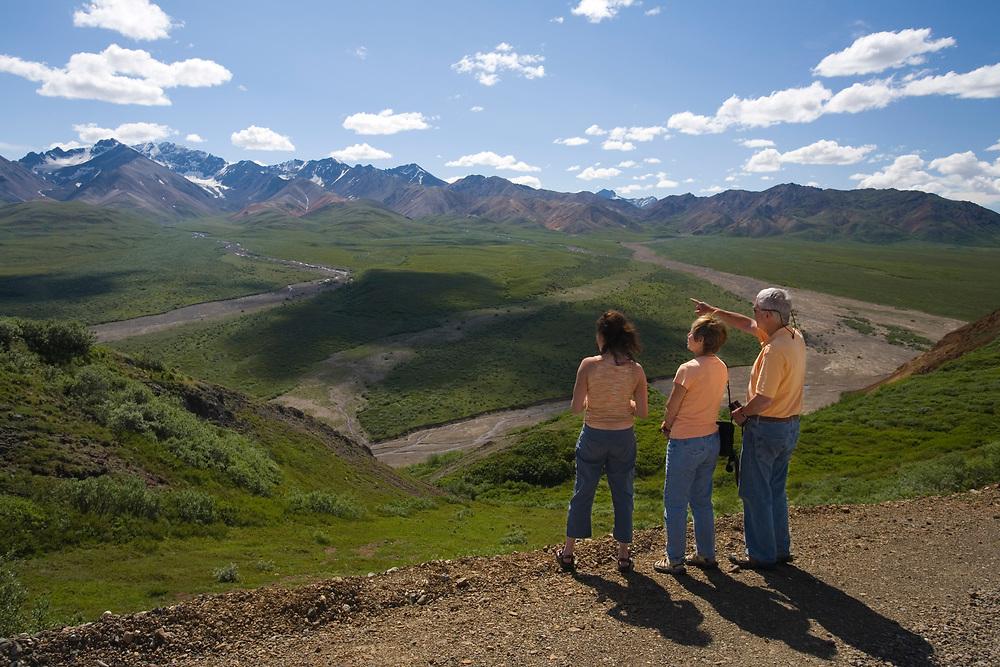 A family enjoys spectacular views from the Denali Park Road on Polychrome Pass, Denali National Park